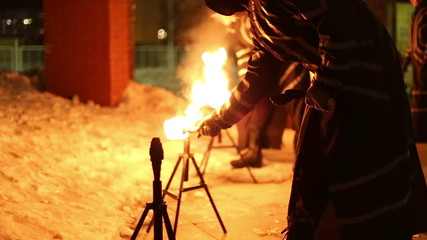 Artists show presentation with fire, set fire to the torches