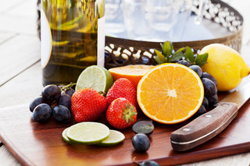 Variety of fruits and bottle of wine for preparing sangria