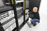 It engineer replace harddrive in datacenter poster
