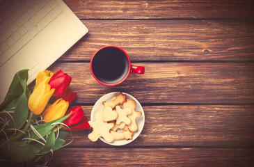 Cup of coffee and cookies with notebook