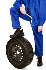 Repairman leg on a tire