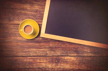 Cup of coffee and blackboard