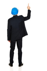 Businessman engineer pointing up
