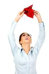 Businesswoman holding empty purse.