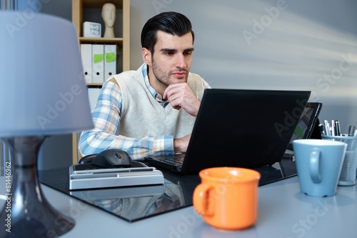 Portrait of working businessman