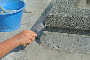 Pebble washworks by construction workers