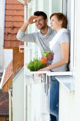 Young couple standing at balcony