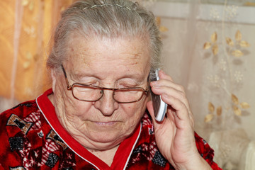 Elderly woman and mobile phone