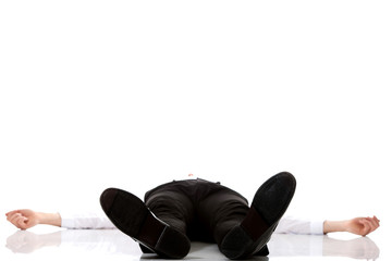 Exhausted businessman lying on the floor.