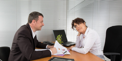 Businesswoman discussing with male colleague