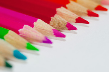 Coloured pencil bar in different pattern on white background