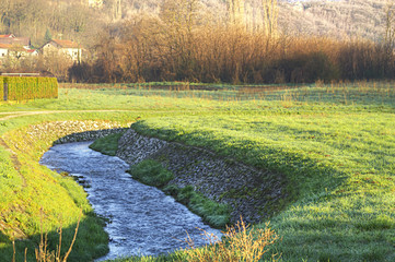 water stream in the meadow