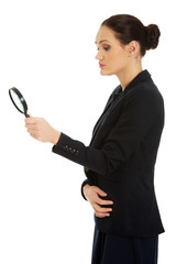 Businesswoman with magnifier glass.