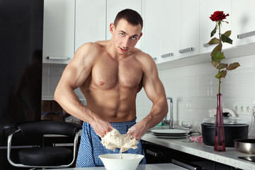 The man hands in the dough.
