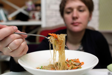 Woman looking at noodles