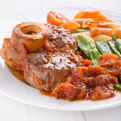 Ossobuco. Сross-cut veal shanks braised with vegetables.