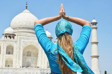 Young woman meditating atTaj Mahal. Agra, India