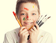 Child with paintbrush