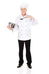 Chef holding stainless steel pot and spoon