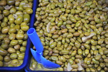 Green olives in market stan