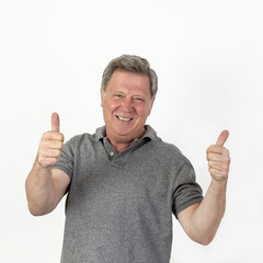 smiling mature man with grey polo shirt
