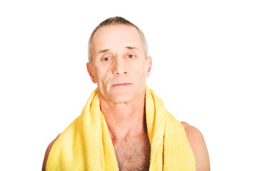 Mature man with a towel around neck