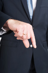 Businessman hand showing small size