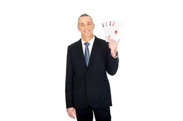 Elegant businessman with four aces