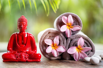 Buddha and flower in towels
