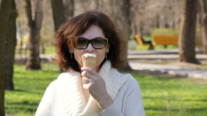 The woman in the park. Ice Cream
