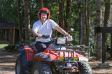 mature man riding a Quad
