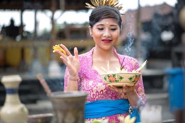Young Balinese woman praying