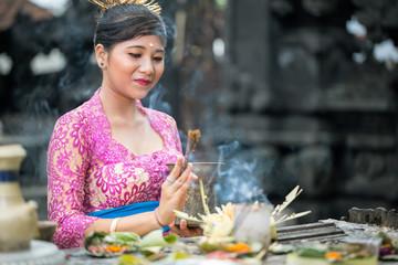 Balinese woman praying
