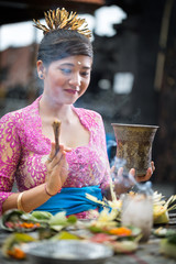 Young Balinese woman praying