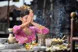 Beautiful Asian woman prays in the temple