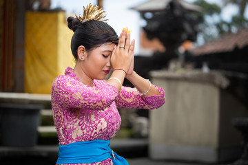 Balinese girl praying