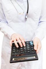 physician calculates the cost of treatment