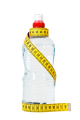 Bottle of water with measuring tape. Dieting concept. Isolated