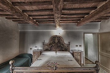 Bedroom with rustic wooden bed