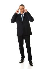 Full length pensive businessman touching head