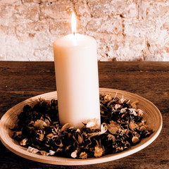 Candle on the wooden plate
