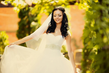 Adorable young caucasian bride in garden
