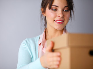 Portrait of pretty woman holding a box