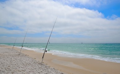 Fishing in Gulf of Mexico on white sand Florida Ocean Beaches