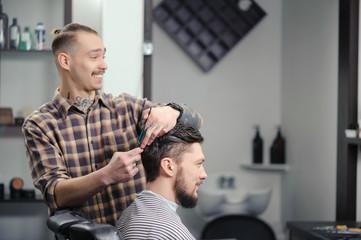 Barber cuts hair of a man