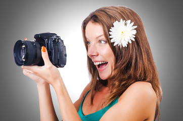 Attractive female photographer on white