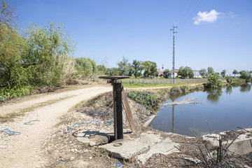 rural dirt road in the countryside, irrigation channel