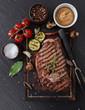 Beef rump steak on black stone table - 81462977