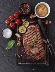 Beef rump steak on black stone table