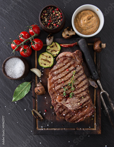 Beef rump steak on black stone table